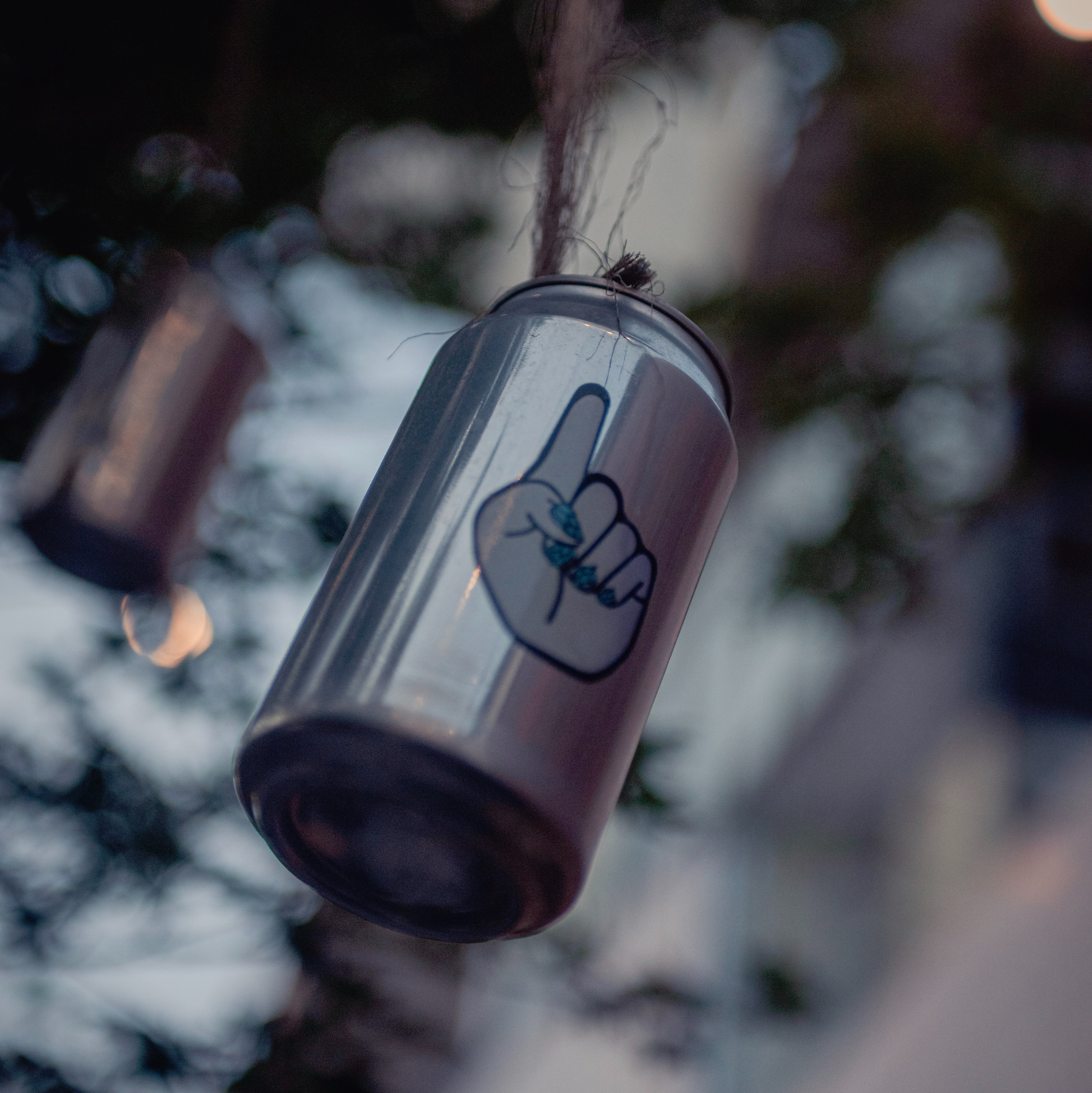 pop can hanging on tree