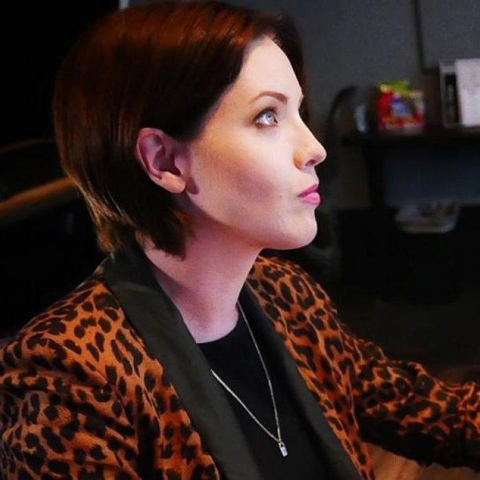 Humber graduate Katie Halliday working at her desk