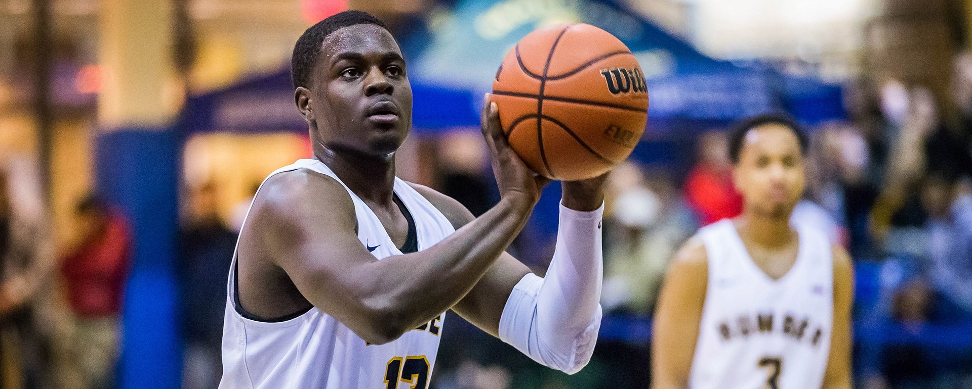 Humber Basketball player about to shoot the ball during a game