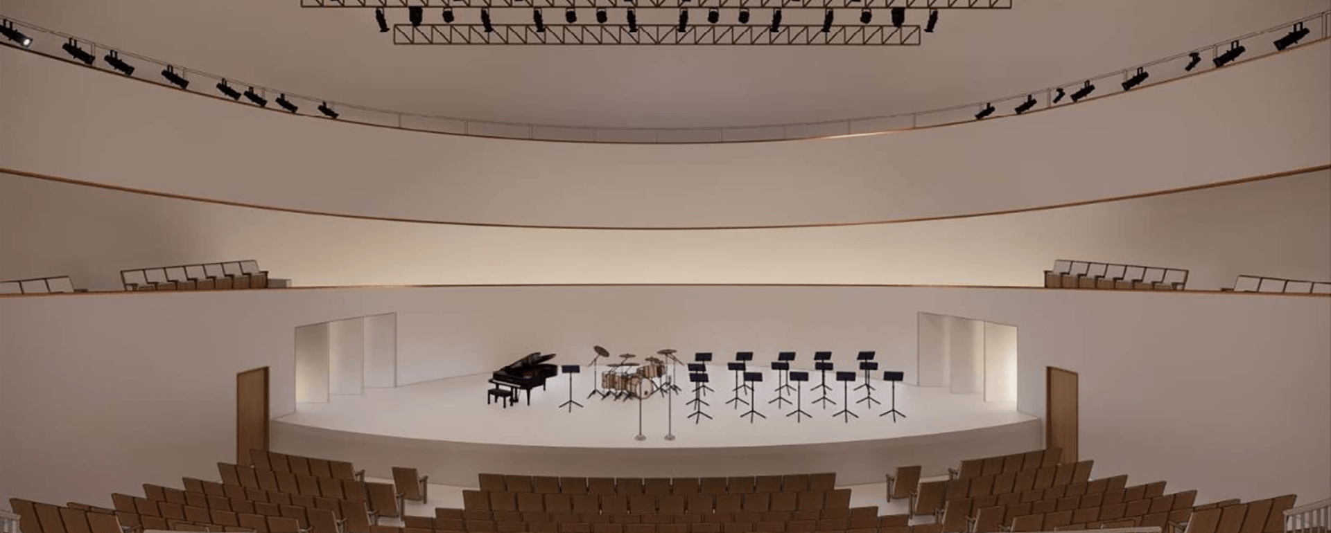 Architect's rendering of a large performance space with musical instruments on stage