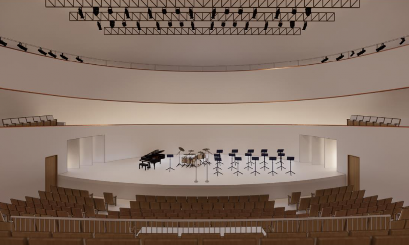 View of a stage from the back of a large performance hall
