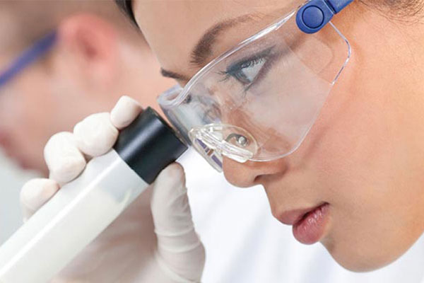 female looking into a microscope