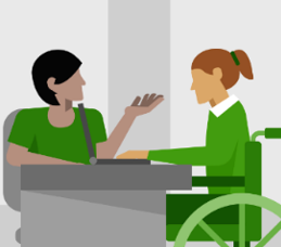 Image of a woman in a wheel chair having a conversation with another woman who is sitting at a desk