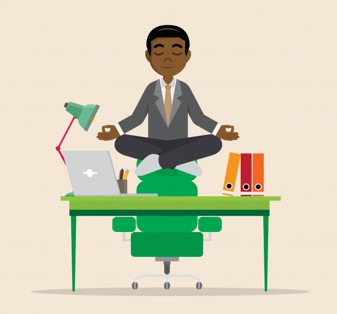 Image of an individual meditating while sitting on-top of a desk