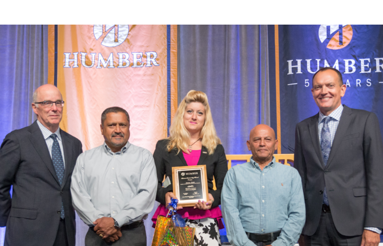 Humber President Chris Whitaker with Recipients of a President's Award Holding a Plaque