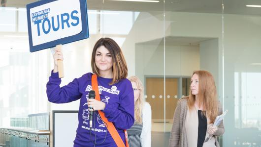 A Humber Ambassador leads future students through a tour of Humber's Learning Resource Commons.