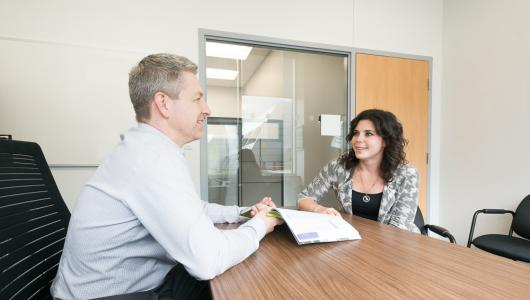 A program advisor meets with a prospective student to help clarify program expectations.