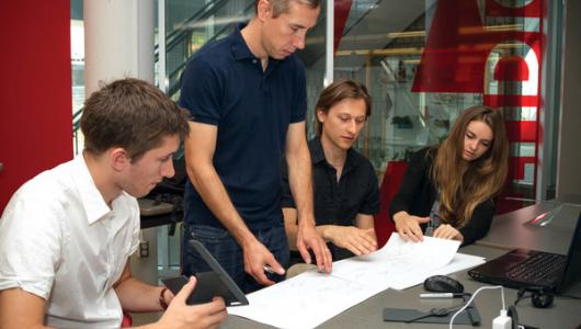 Students working on a project on a table