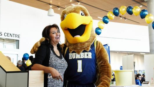 Student with Humber Hawk mascot