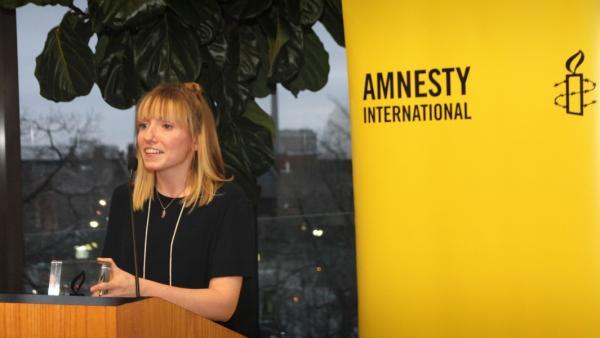 Humber College journalism graduate Deanna Grant accepts the Amnesty International Canada Youth Media Award. Photo by Danilo Ursini.