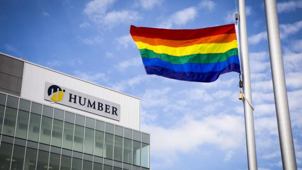 The rainbow flag hangs at half mast outside Humber College on June 13, 2016.