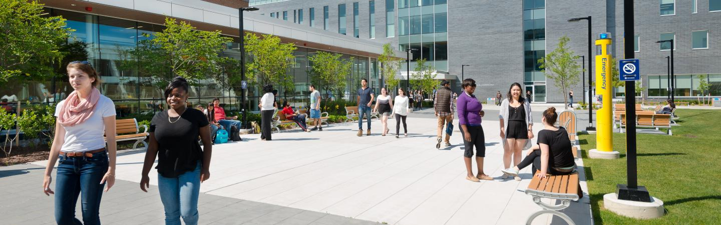 Humber students in the North campus courtyard between the Learning Resource Commons and the NX building.