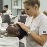 Students work on each other in the Humber Spa