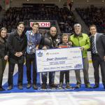 Humber College business students present Camp Oochigeas with a cheque for $28,210 at the Marlies game on April 8.
