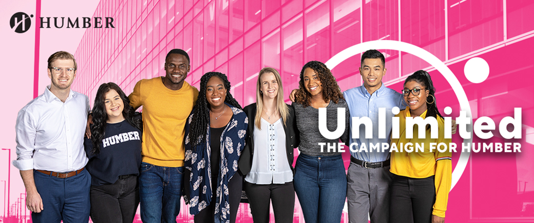 Students standing in front of Unlimited logo and LRC