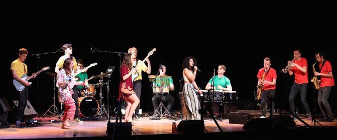 Student twelvetet performing on stage