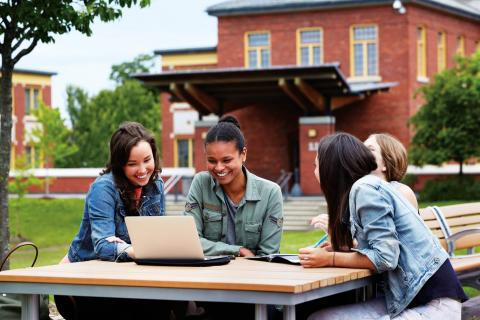 Students gathered outdoor table