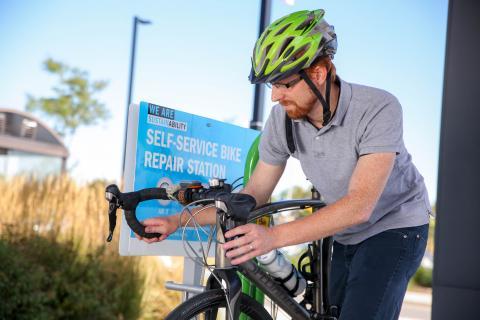 Student using the bike repair station