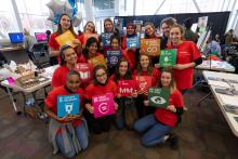Group of students holding the SDGs