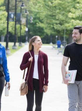 three students walking together and laughing