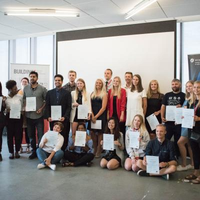 Humber, Business Academy Aarhus and Sinclair Community College students being presented with their certificates of completion