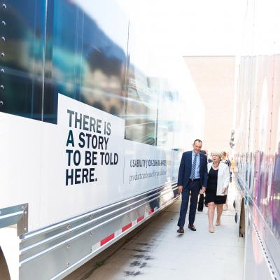 Dr. Chris Whitaker walks The Honourable Deb Matthews to the School of Media Studies and Information Technology's mobile Usability Lab.