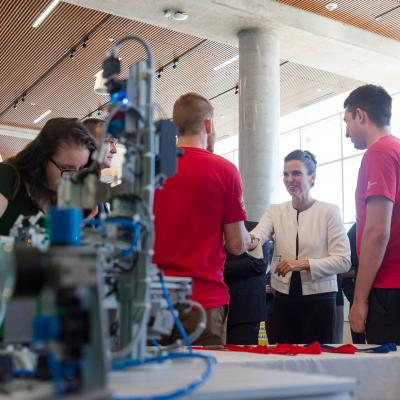 Avery Bird shakes hands with Honourable Kirsty Duncan, Minister of Science and Member of Parliament for Etobicoke North, at Humber College North campus.