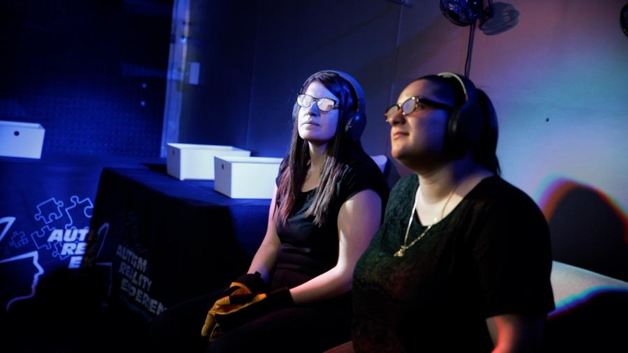 Two participants of the Autism Reality Experience during its stop at Humber College