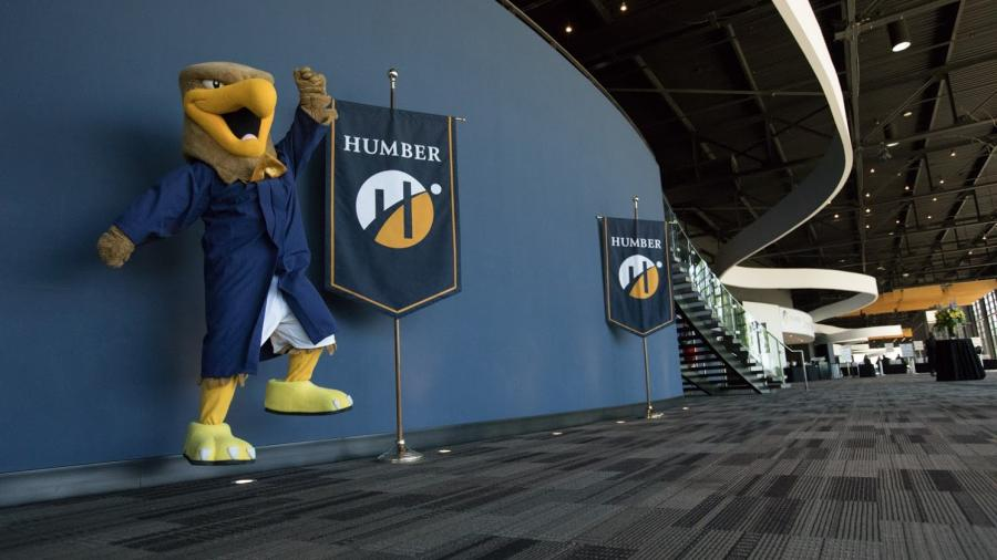 Howie the Hawk celebrates the start of Humber Spring Convocation