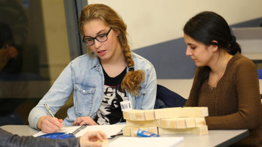 Humber student tutoring another student.