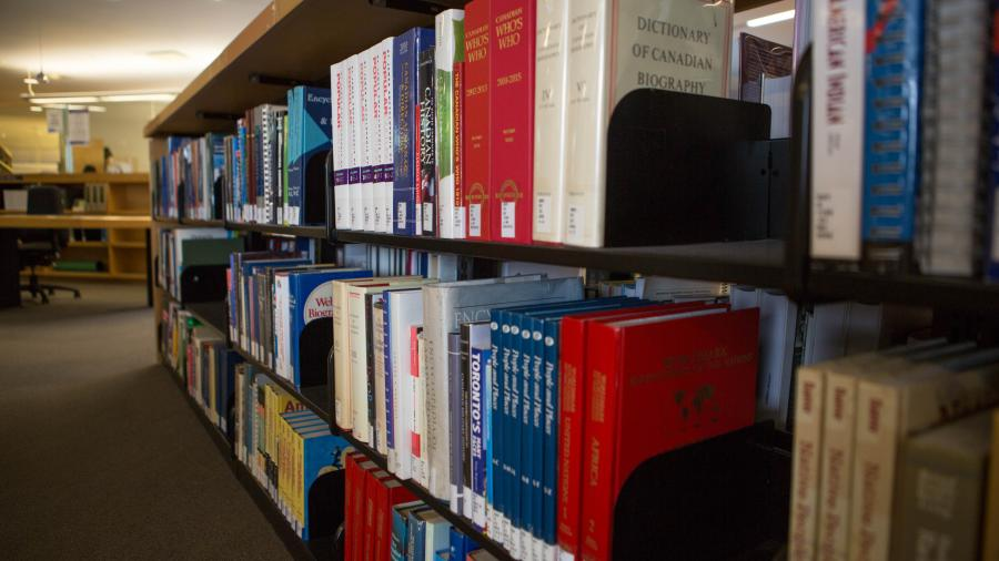 A library stack at Humber College holds rows and rows of colourful books.
