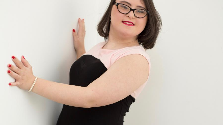Jessica Rotolo poses in a black dress for a fashion photo
