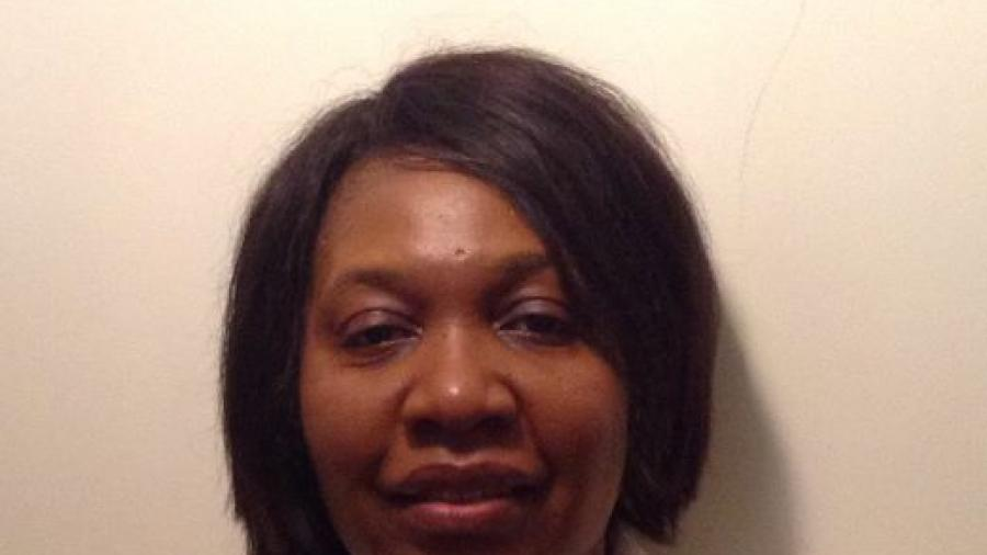 Math professor Priscilla Bengo smiles in a headshot, seen from the shoulders up. She has black hair cut into a bob