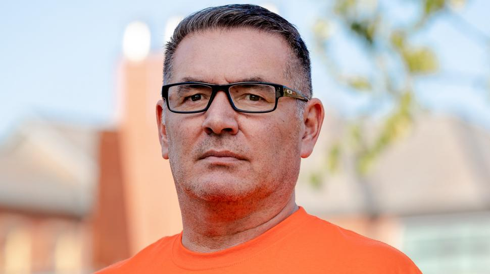 Dean Jason Seright wears an Orange Shirt Day shirt on North campus