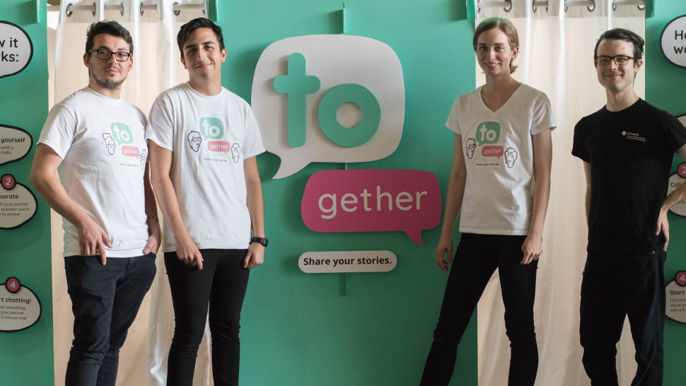 Students standing proudly infront their interactive installation called TOgether