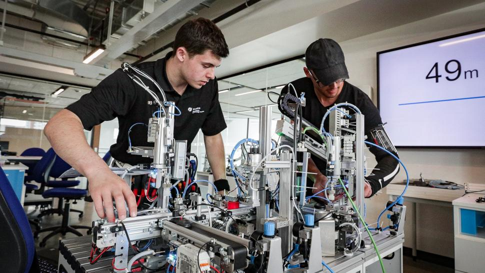 Two students work on a project in the Skills Training Mechatronics Room at the Barrett CTI