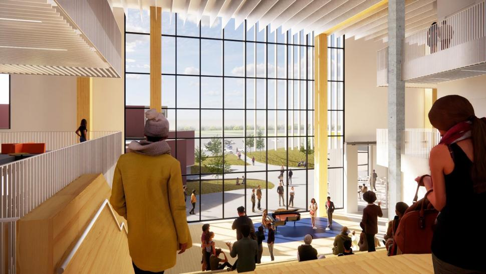 The Humber Cultural Hub entrance is cream-coloured with a wall of windows and tall ceilings. People are walking milling about