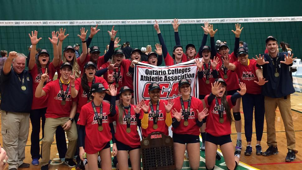 The Humber Hawks women's volleyball team celebrates their 10th consecutive championship win