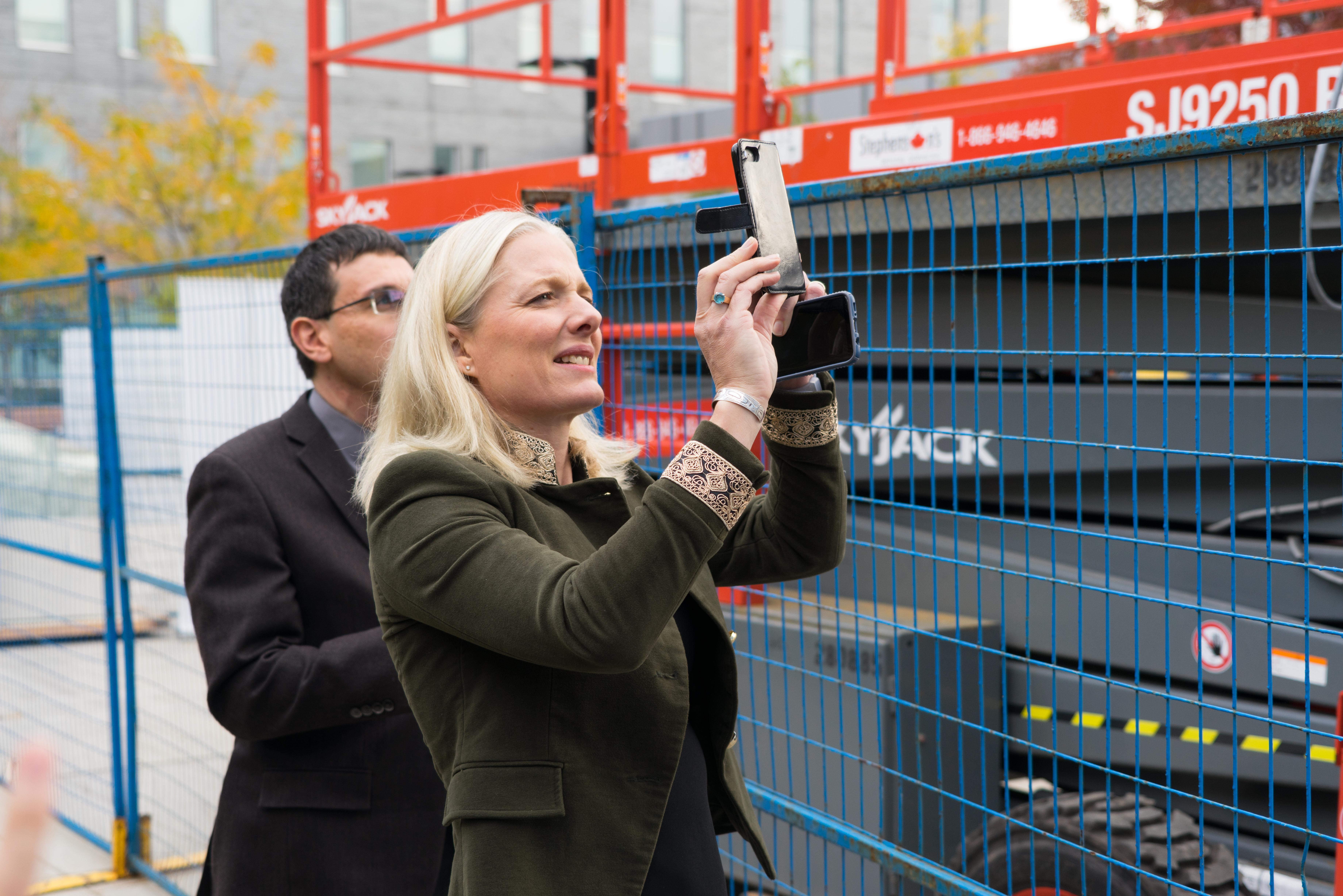 Catherine McKenna checks out the work being done on Humber's NX building