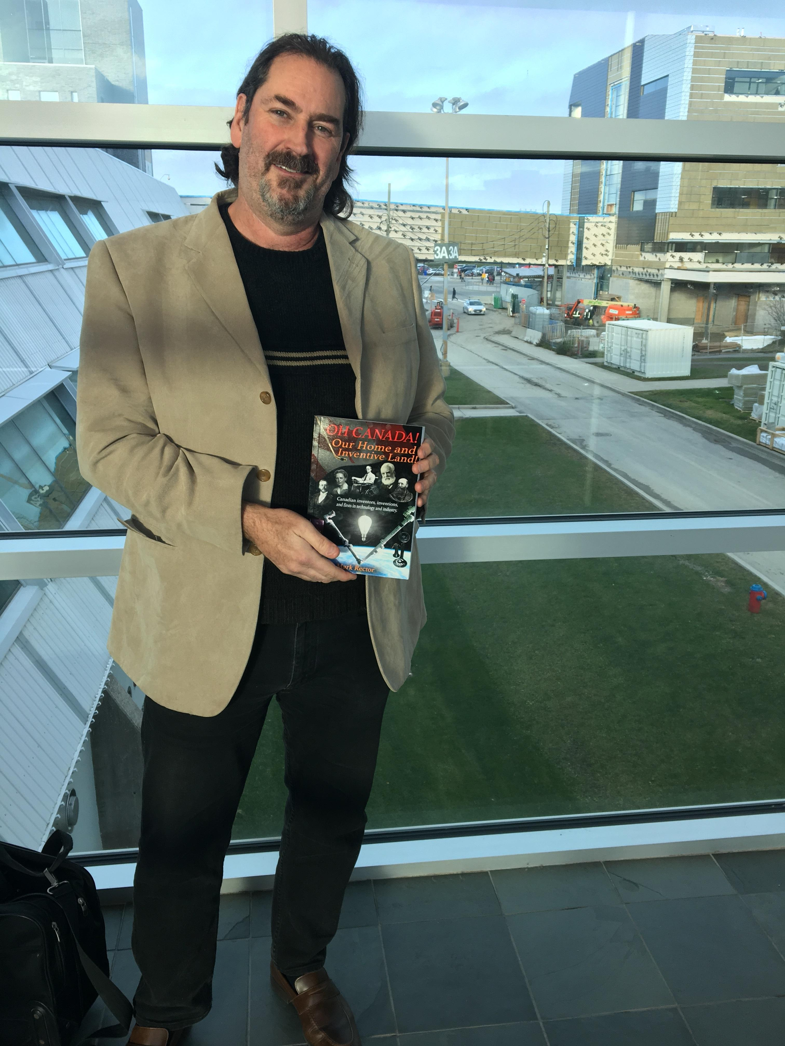 Professor Mark Rector with his book