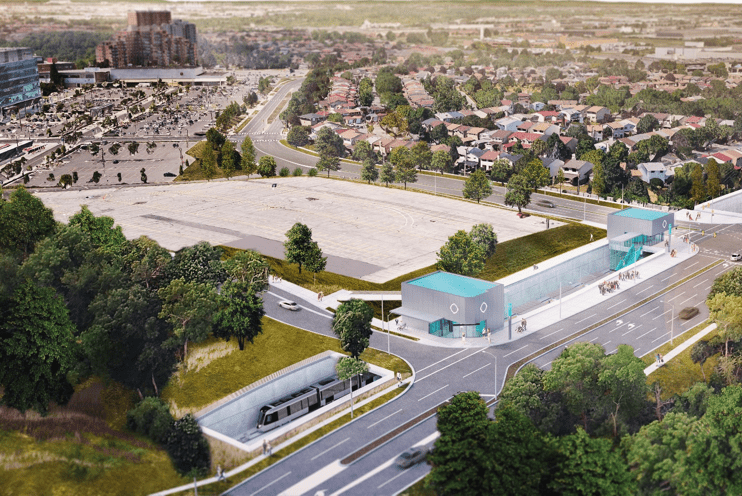 An aerial view of Humber's North Campus with a rendering of the new transit station located at the entrance off the highway