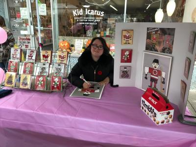 Jessica Rotolo sells her art from a table set up at Kid Icarus