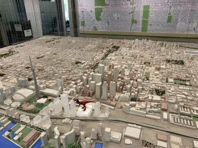 The original Tiny Town model sits on a giant table at City Hall, showing a large swatch of the city's streets and buildings