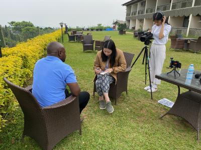 Photo of Harmony Multani interviewing a subject while Lucy Lau films them