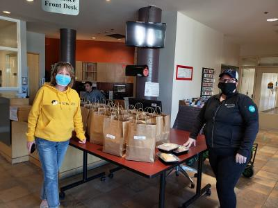 staff wore masks and gloves to handle the meals