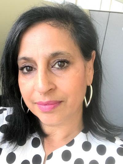 ManjitJheeta, the director of strategic partnerships at theCity of Toronto, smiles, closemouthed, in a headshot