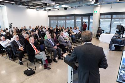 Event attendees listen to a presenter.