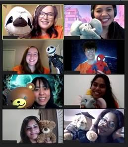 A computer screen is split into eight, showing eight students on a Zoom call, each holding stuffed animals.