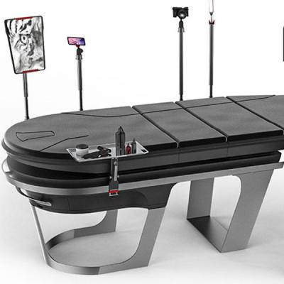 Bradley Staite's Neo Ink tattoo table looks like a customizable massage table and desk with various black and chrome attachments