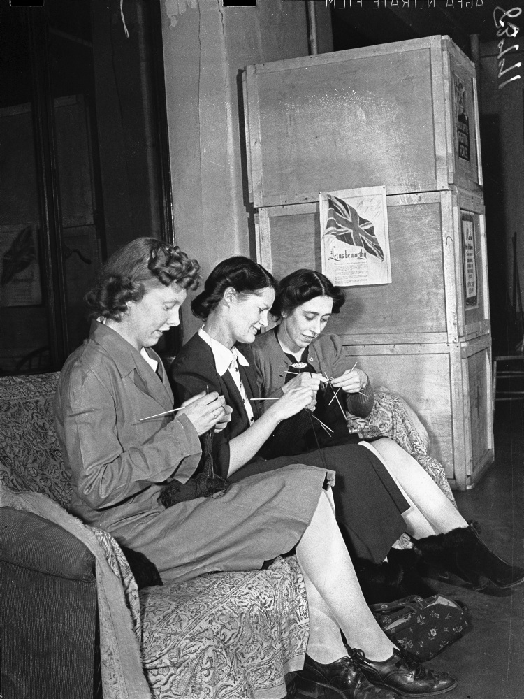 Three women knitting at Red Cross centre during the Second World War
